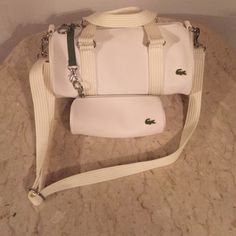 Ladies Bag by Lacoste Ladies Bag by Lacoste: ThisBag is new however, the tags have been removed. Great Deal! Lacoste Bags