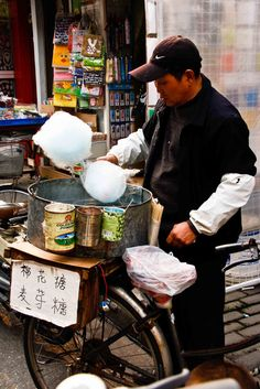 Cotton candy? A Chinese street food? You'd better believe it, Chinese people love cotton candy (miánhuā táng, or fairy floss, as we call it in Australia) and you can find cotton candy vendors anywhere in Shanghai there's a large happy crowd gathered. Outside temples are favourite spots, and many Chinese temples have a perpetual festival atmosphere where the shopping and snacking are as important as the worshipping.