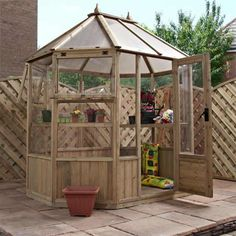 Octagonal greenhouse. http://www.worldstores.co.uk/p/Winchester_8ft_x_6ft_%282.42m_x_1.87m%29_Octagonal_Greenhouse.htm