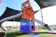 This custom three-cube climbing structure stands tall on an elevated platform looking over a safe space for kids to learn to ride their bike or scooter. Modern Playground, Playground Slide, Natural Playground, Playground Design, Outdoor Playground, Playground Ideas, Cubes, Kids Climbing, Landscape Architecture Design