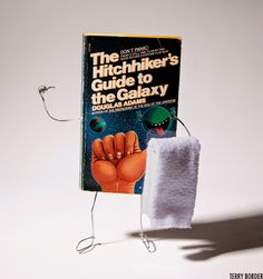 Terry Border's Wiry Limbs Paper Backs - Hitchhiker's Guide to the Galaxy The Hitchhiker, Hitchhikers Guide, Galaxy Cake, Guide To The Galaxy, 1st Birthdays, Interstellar, Conceptual Art, Little Books, Guardians Of The Galaxy