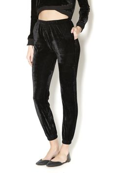 We love these elastic waist black velour pants. Comfort takes a turn for the best in these easy to wear pants. Style them up or down!