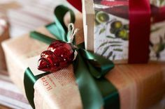 Great gift wrapping idea! Give a present a special touch and tie an ornament to the ribbon.