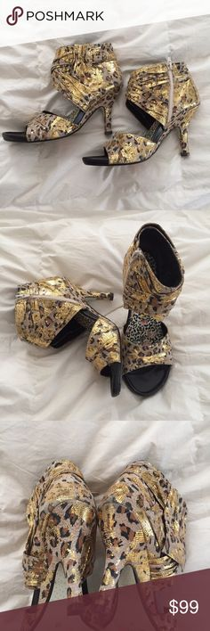 "Irregular Choice Gold Metallic Leopard heels 39 9 This is a beautiful pair of Irregular Choice heels. Gold metallic leopard fabric. Size 39/9. Heel 3.5"". A little above the Ankle and zips closed. Mint condition. Irregular Choice  Shoes Heeled Boots"