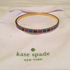 Kate Spade bracelet Gold lined, with blue, purple and brown stripes kate spade Jewelry Bracelets
