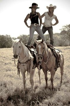 Cowgirls goofing around with their horses