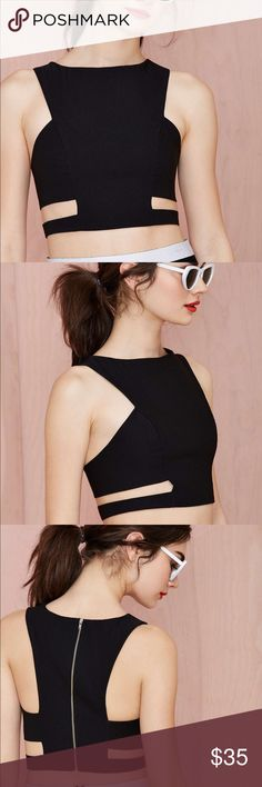 NastyGal Sidestep Crop Top The ultimate in modern classics, for the chic at heart. This structured crop top manages to make cut outs look ultra chic. Thick but stretch fabric keeps its form so you look polished at all times. So cute with high waisted trousers or culottes. Worn once, fabulous condition. Nasty Gal Tops Crop Tops