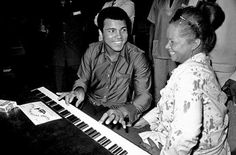 RIP Etta James (1938-2012)    This is her chatting with Muhammad Ali at the piano at the Kinshasa Hotel in Zaire in September 1974. James and other African American musicians were in the country to perform at the Zaire 74 music festival. The concert was organized as a promotional event to coincide with the heavyweight championship boxing match between Ali and George Foreman.