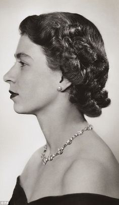 Stunning photos chart the Queen's 63 years on the throne as she prepares to overtake Victoria as the UK's longest-reigning monarch. 8/17/15 |  This striking profile portrait was taken in February 1952