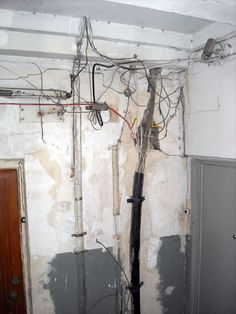 I always wondered if this wiring, visible in the stairwell of our apartment building, was to code. Then I remember, there's no code...