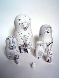 white animal stacking dolls