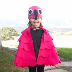 A simple DIY Flamingo Costume, complete with flapping wings and a curved beak. Great for kids and adults!