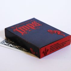 Whispering Imps, Black Edition Beautiful Blinds, Blind Embossing, Black Company, Bicycle Cards, Card Companies, Red Paper, Black Edition, Foil Stamping, Cool Cards