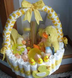 Not too keen on the diaper cake idea? Grab a diaper basket like this diaper basket centerpiece ($75) by Teresa Phillips to keep the tradition without lifting a