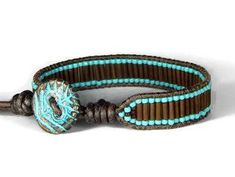 Sticks and Stones leather wrap bracelet I used USA leather cord as the foundation for this bracelet, with rustic brown bugle beads and turquoise seed beads. The button is ceramic leaf imprint design. The bracelet closes at about 7.5 and 8.5, adjustable. The width of this bracelet is about