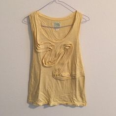 Anthropologie winding road tank in yellow Cute yellow tank with ruffles that run across the front. Cotton. I'm good used condition. Anthropologie Tops Tank Tops