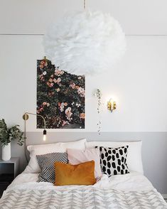 Use colorblocking to ground your bedding. This technique does double duty for wall paneling or chair rails in a cool modern way. A subtle shade of grey doesn't overwhelm your space.