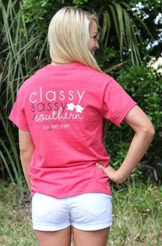 """Southern darlin' collection is a southern lifestyle brand. This heather red tee features """"Classy, Sassy & Southern """" back design with bow. Front features the Southern darlin' logo with anchor...."""
