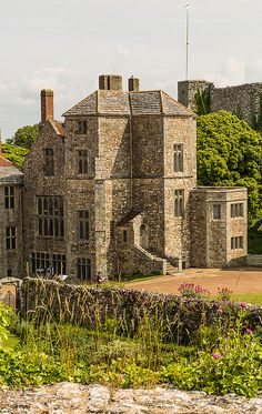 Carisbrooke Castle is a historic motte-and-bailey castle located in the village of Carisbrooke, near Newport, Isle of Wight, England. Charles I was imprisoned at the castle in the months prior to his trial. - The site of Carisbrooke Castle may have been occupied in pre-Roman times.