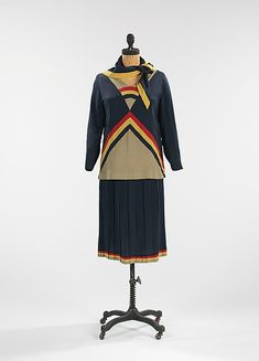 Silk and cotton day dress with scarf, probably French, ca. 1923. This day dress encompasses the spirit of the modern woman. The 1920s were a liberating decade, as women became more independent, changing their role in society. The tubular silhouette was in vogue, as well as a shorter skirt, rising above the ankle and eventually above the knee.