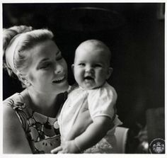 Princess Grace holds Princess Stéphanie