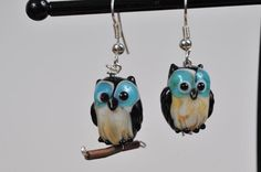 A personal favorite from my Etsy shop https://www.etsy.com/listing/85998299/owls-owl-earrings-owl-jewelry-lampwork