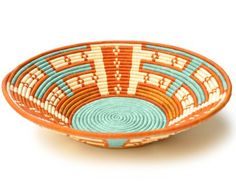 i picked up baskets like this while in Uganda. love them as decor pieces, great gifts too!