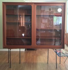 danish modern 60s sideboard with glass doors mid century cabinet furniture and glasses