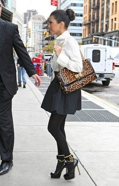 Kourtney jazzed up her chic look with a must-have bag of the moment, the Sweet Charity bag in an on-trend leopard print.