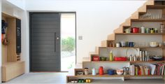 oversized front door. stairs + shelving. entry storage + blackboard. all around amazing. kathryn tyler design.