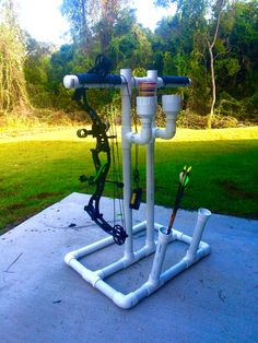 Pvc bow hanger with cup holders and arrow slots