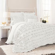 Outfit your guest room or master suite in feminine style with this lovely comforter set, featuring a ruffled design.  Product: