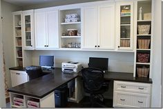 Future his/hers office :)  Like the dark wood counter top with white shelves/cupboards