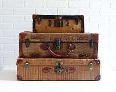 Ahh. Wicker. Vintage Suitacases.  It feels like a scene from a musical like the Sound of Music.    Antique Straw Suitcases, an Instant Collection of Three.via Etsy.