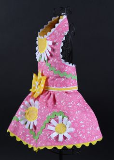 Custom dog dress! Shipment in three (3) weeks from purchase. Your little princess will be ready for spring in this stylish casual dress! Fabric: Cotton Bodice Color and Details: Pink daisy pattern with grosgrain ribbon daisy detail Skirt Color and Type: Gathered with grosgrain ribbon