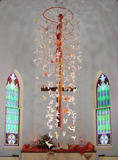 a mobile of doves ..... with Baptism dates. Could be a way to honor new members and membership date