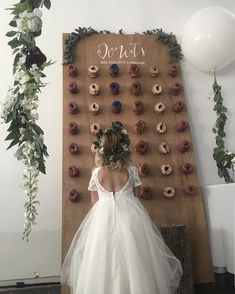 Choosing the right food for your wedding can be hard. How do you celebrate your special day, stay under budget, and wow your guests with food that actually tastes good? The latest trend in wedding sweets might just help you out. We're about to enter the era of the doughnut wall.