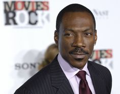 "Eddie Murphy arrives at ""Movies Rock: A Celebration of Music in Film,"" at the Kodak Theater in Los Angeles, Sunday, Dec. Eddie Murphy, Steve Harvey, Colin Firth, Jim Carrey, George Clooney, Saturday Night Live, Top Gun, Brad Pitt, Johnny Depp"