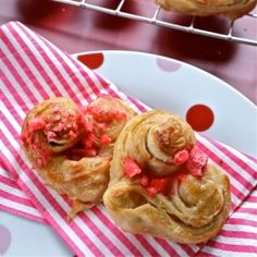 Krushchev dough rolls in palmier style heart shape scattered with pink praline