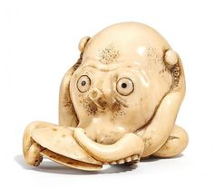 Netsuke OCTOPUS WITH CLAM. HIPPOPOTAMUS TOOTH. SIGN.: MASATOMO. First half of the 19th century.
