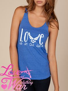 LOVEANDWARCLOTHING - Love is in the air tank top, $24.95 (http://www.loveandwarclothing.com/love-is-in-the-air-tank-top/)