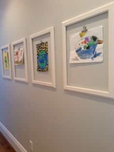 Frames with clips to display children's art work. Love this idea!