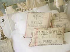 Le Toile Royale Pillow. A medium sized pillow covered in soft distressed muslin with an image of a French feed sac. $32