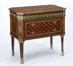 """1780 French Chest of drawers at the Victoria and Albert Museum, London - From the curators' comments: """"This piece of furniture combines a chest of drawers and a secretaire. The top surface moves back and, at the same time, the drawer slides forward, to provide a writing surface."""""""