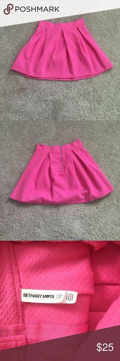 Pink Circle Skirt This hot pink skirt is a must have in any girly girls closet. It give your outfit a fun pop of color and can be worn year round. In the winter and fall pair it with tights and a sweater and in the spring and summer wear it with blouses and tanks. Aeropostale Skirts Mini