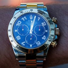 """The watch every man should own, the #Rolex Cosmograph Daytona is the epitome of luxury. The term """"Cosmograph"""" is a word created by Rolex, which first appeared in the 1950s to describe a watch with a moon phase and calendar function. Shop it now! #RolexDaytona #RolexCosmograph Rolex Cosmograph Daytona, Rolex Daytona, Rolex Watches For Men, Chronograph, Elapsed Time, Jewels, Crystals, 1950s, Shop"""