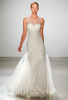 A gorgeous @amsale wedding dress with a tulle overskirt and illusion neckline   Brides.com
