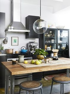 Like the glass display cabinet - not too keen on the industrial feel though and have never really like breakfast bars so would replace that with a big eat in dining table instead