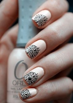 Neutral nails with black lace accents