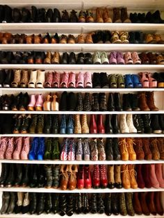 Lots and lots of glorious footwear. Neat shelves and colour coordinated. That's right.
